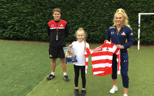Foundation's kit design competition winner presented with Belles shirt by club captain Sophie Scargill
