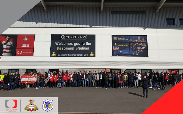 Refugees and Fit Rovers join together to walk to the stadium