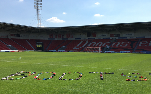 Club Doncaster begin handover of donated boots to DCC United