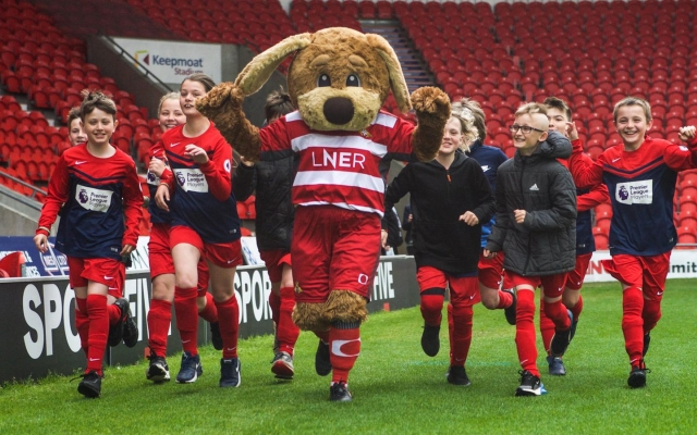 Doncaster children complete laps of Keepmoat Stadium pitch for 'Mile for Mind' during Mental Health Awareness Week