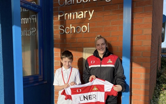 Literacy event winner receives signed Doncaster Rovers' shirt